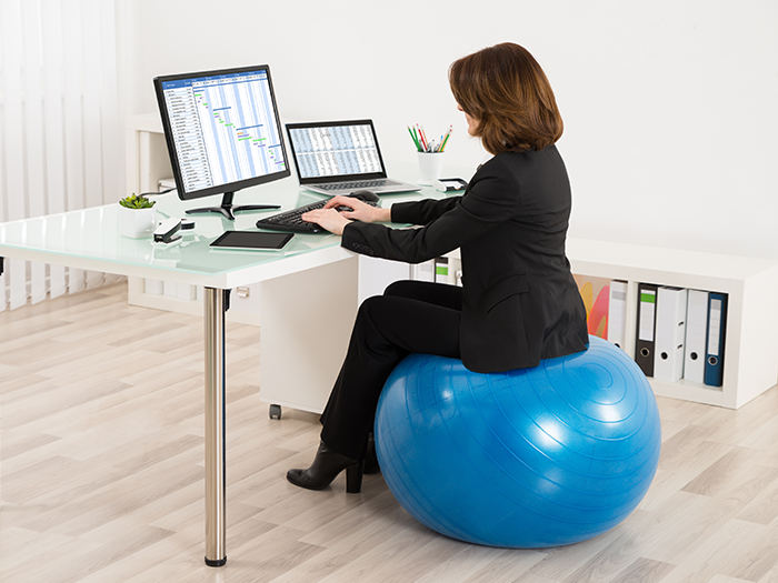 you sit on a wellness ball at work? maybe you shouldn't.