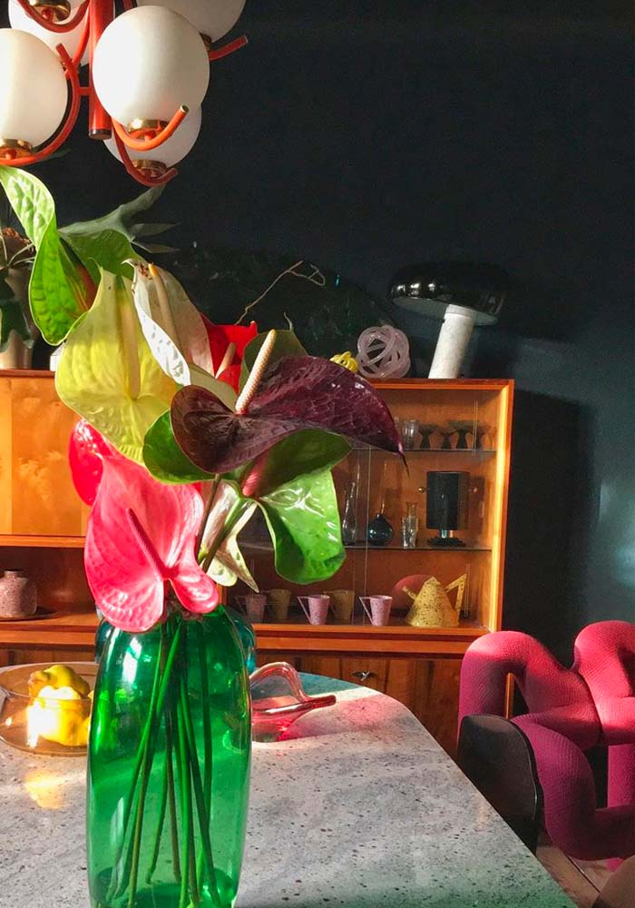 flowers in vase and Ekstrem chair in background in living room