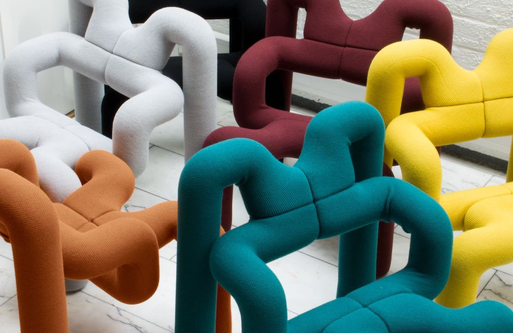 A collection of Ekstrem chairs displaying all available colors
