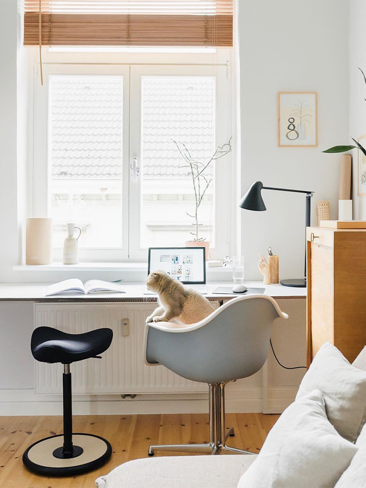 Move stool by desk in Antonias lightfilled home
