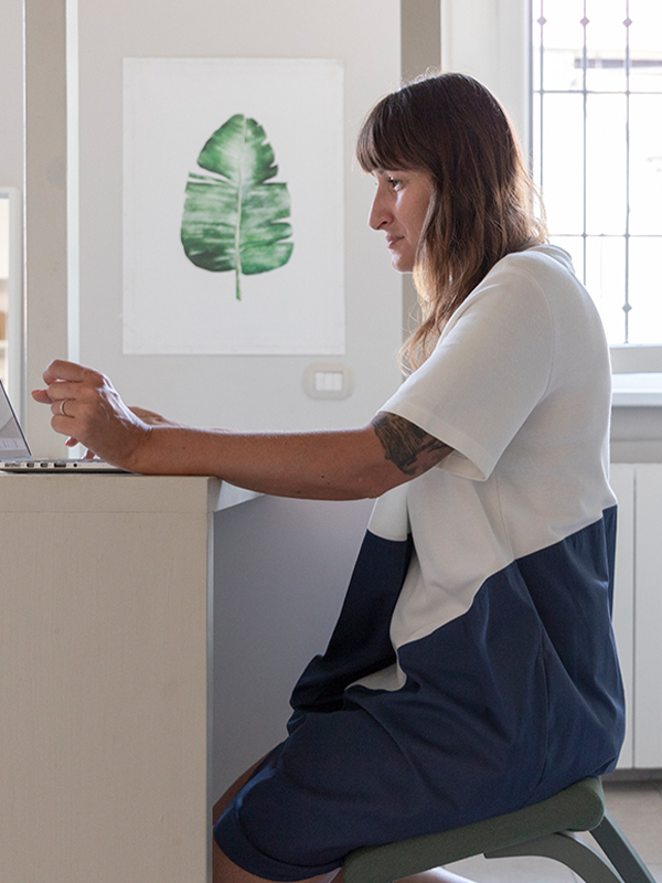 Woman sitting on chair at her office desk